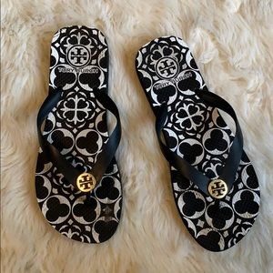 Tory Burch flip flops in black and white gold logo